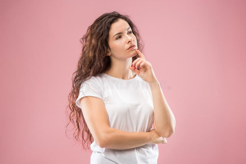Young serious thoughtful business woman. Doubt concept. Remember all. Let me think. Doubt concept. Doubtful, thoughtful woman remembering something. Young royalty free stock image