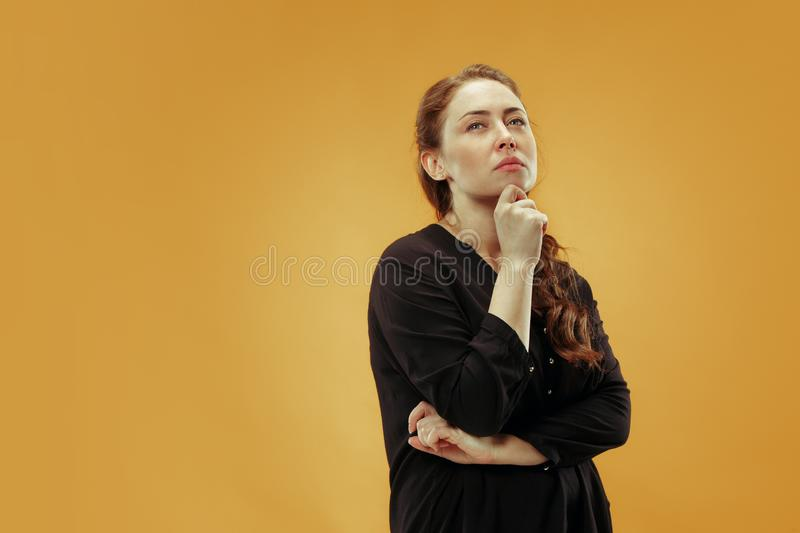 Young serious thoughtful business woman. Doubt concept. royalty free stock image