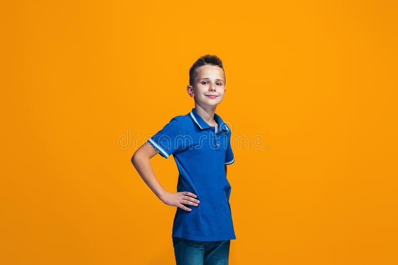 Young serious thoughtful teen boy. Doubt concept. stock image