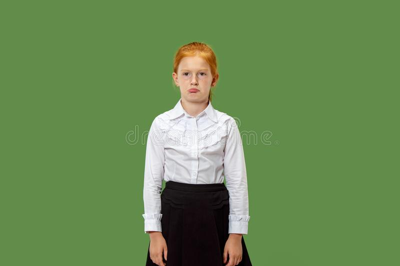 Young serious thoughtful teen girl. Doubt concept. stock images