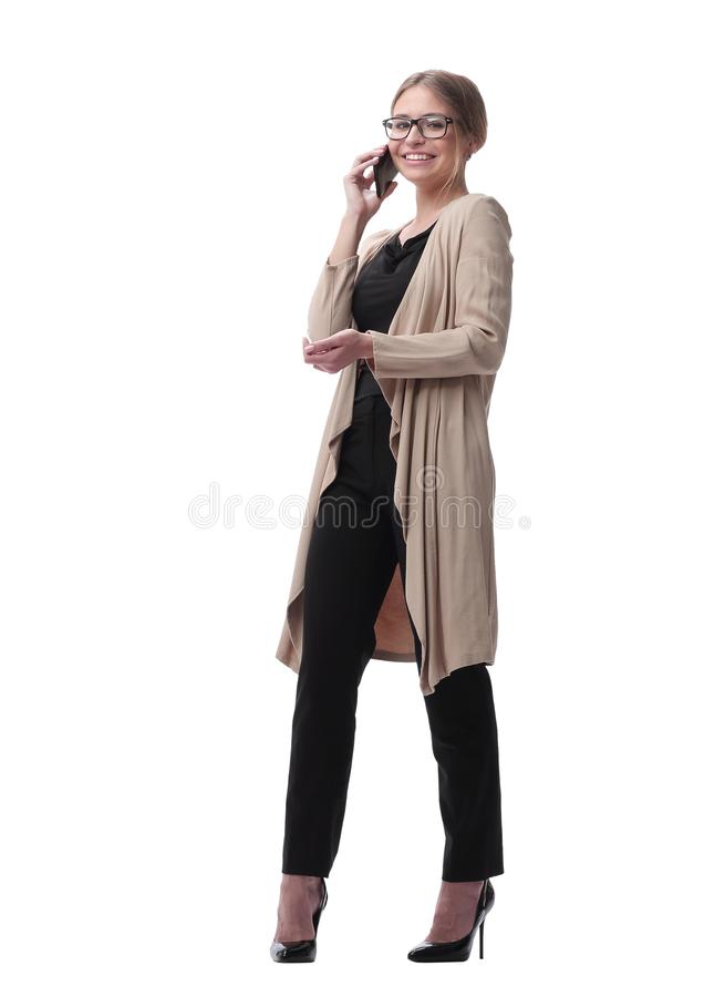 Young serious woman talking on the phone. isolated on white stock photos