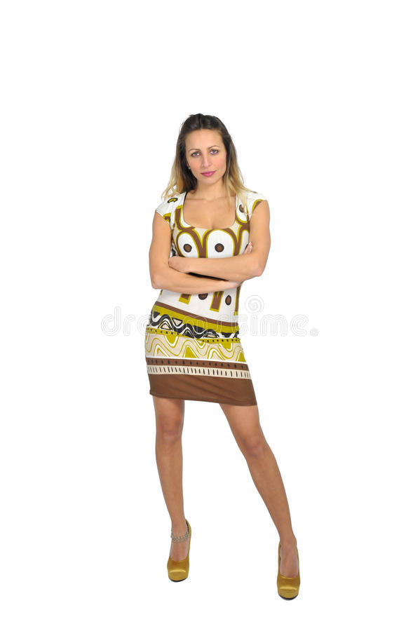 Young attractive woman wearing short trendy dress and high heels posing as fashion model royalty free stock image