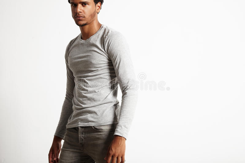 Young black model wearing light gray longsleeve t-shirt stock images