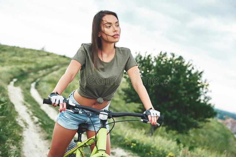 Young woman on a bike. Close up stock photo