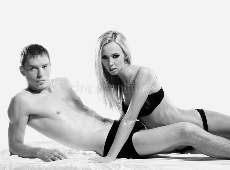 A young and sexy couple in erotic lingerie