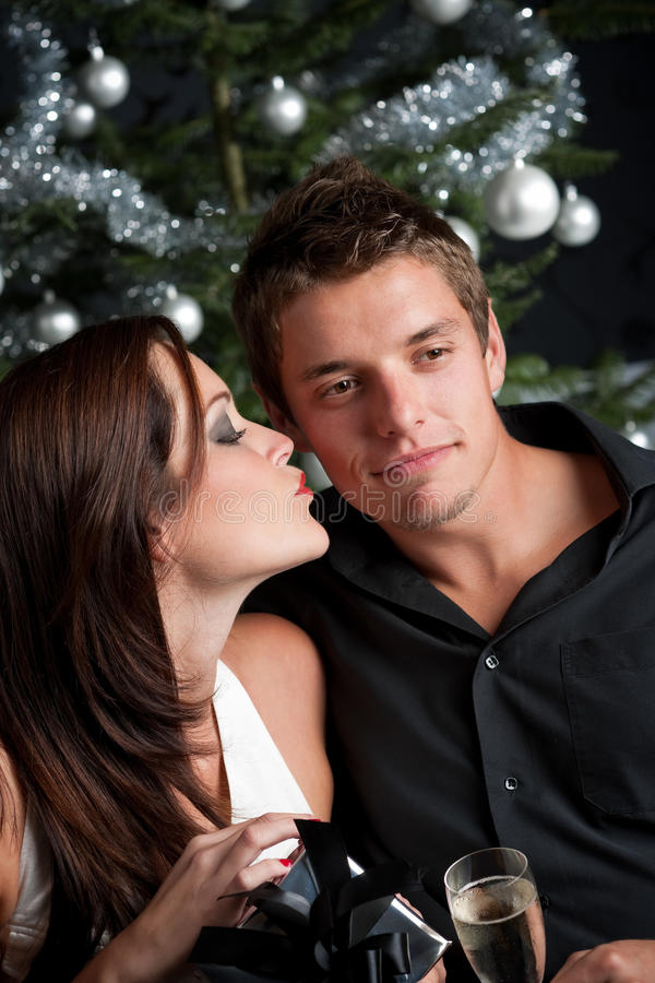 Download Young Couple In Front Of Christmas Tree Stock Photo - Image: 11269772