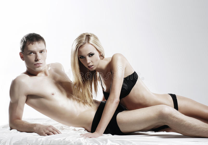 A Young And Couple Laying In Black Lingerie Royalty Free Stock Images