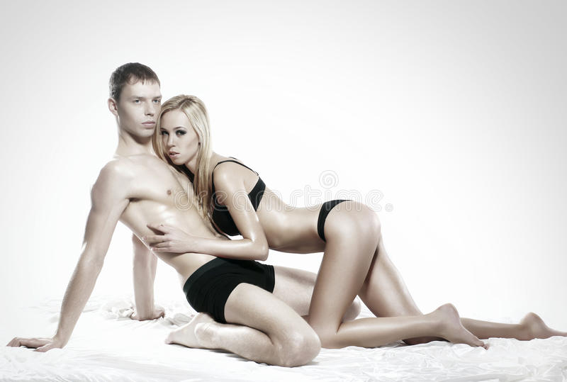 Download A Young And Couple Relaxing In Black Lingerie Stock Image - Image of healthy, human: 33951383