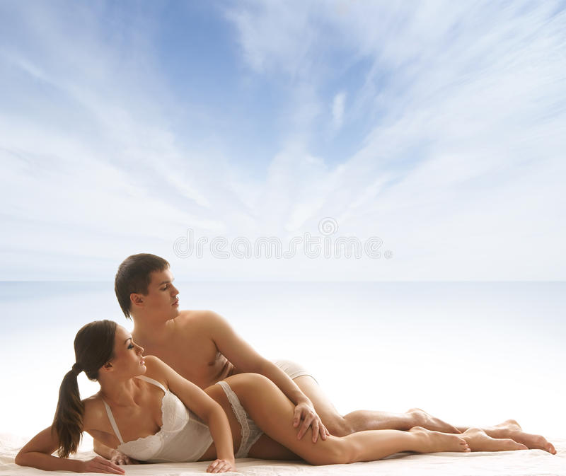 Download A Young And Couple Relaxing In Lingerie Stock Image - Image: 28961879