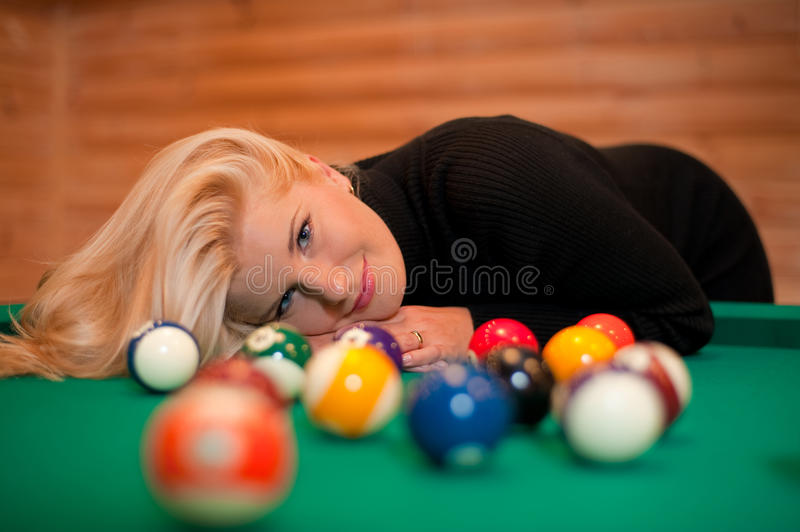 Young sexy girl with billiard balls