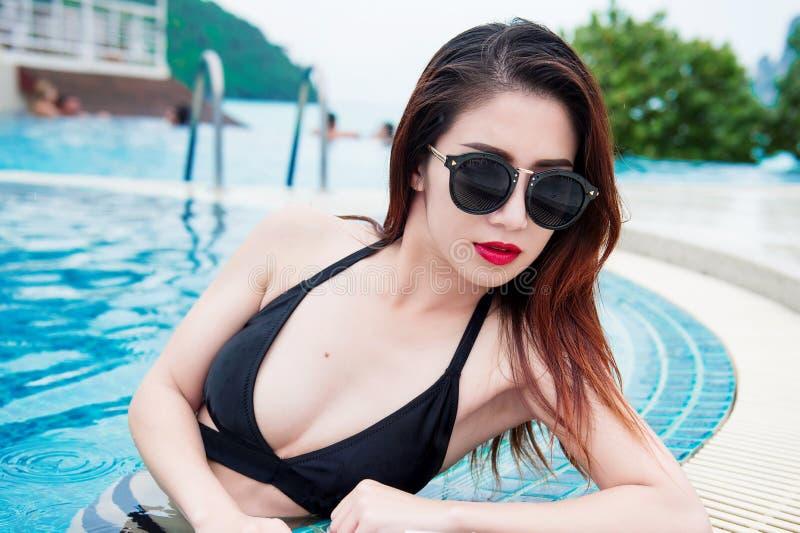 Young girl in black bikini at swimming. stock images