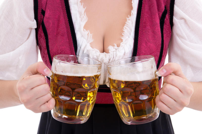 Young oktoberfest woman wearing a dirndl holding two beer m stock photos