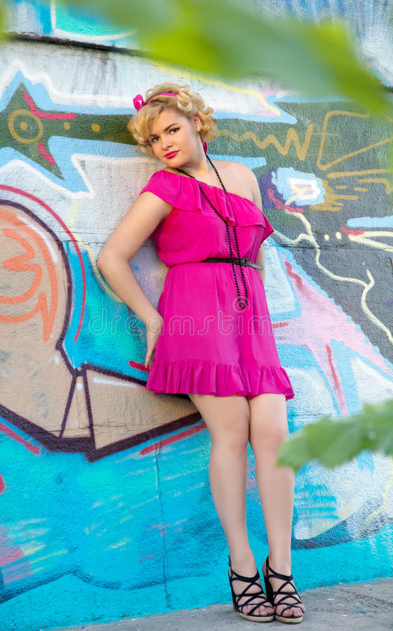 Young Pinup Woman Posing Near Graffiti Wall Stock Photo