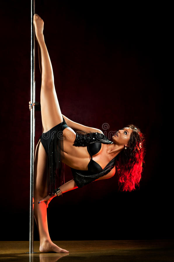 Young pole dance woman stock photos