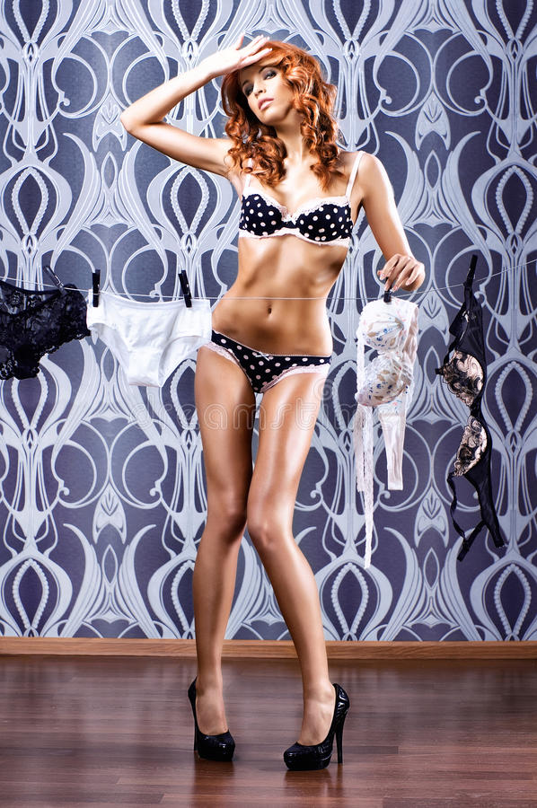 Download A Young And Redhead Woman Posing In Lingerie Stock Image - Image: 25240269