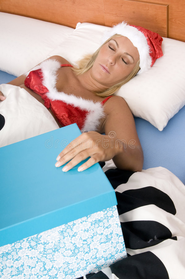 Young Santa Dreaming With Her Job Royalty Free Stock Photography