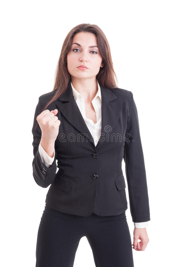 Young successful and powerful business woman showing fist. Isolated on white background royalty free stock image
