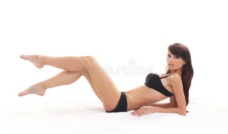 Young sexy woman in black lingerie over
