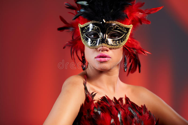 Young woman in black party half mask. May be use for fashion makeup concept royalty free stock photography