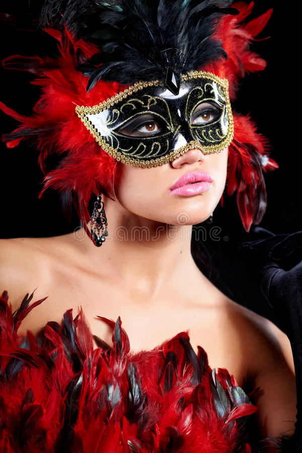 Young woman in black party half mask. May be use for fashion makeup concept stock images
