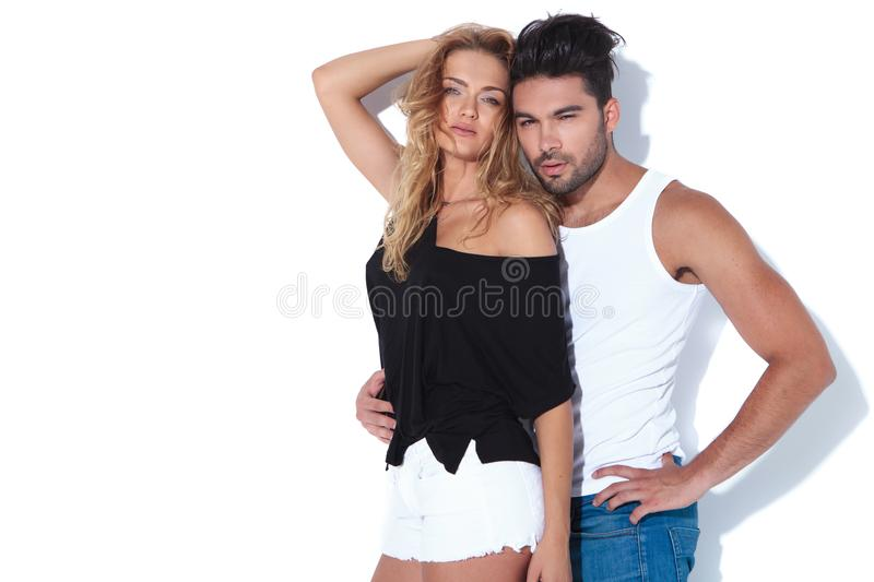 Young woman embraced by man. Young women embraced by men on white background stock photo
