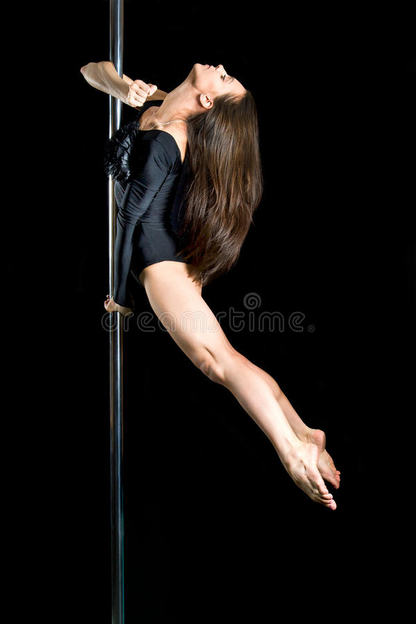 Download Young Woman Exercise Pole Dance Stock Photo - Image: 26084834