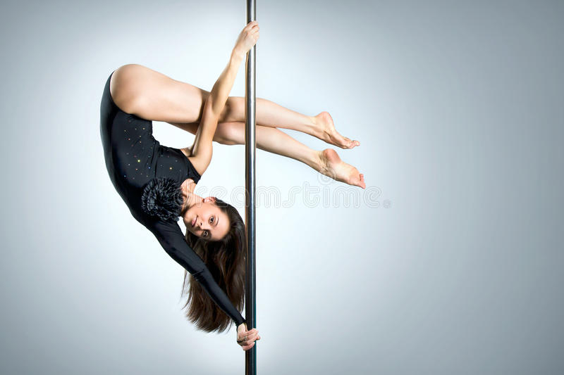 Download Young Woman Exercise Pole Dance Stock Image - Image: 26191609