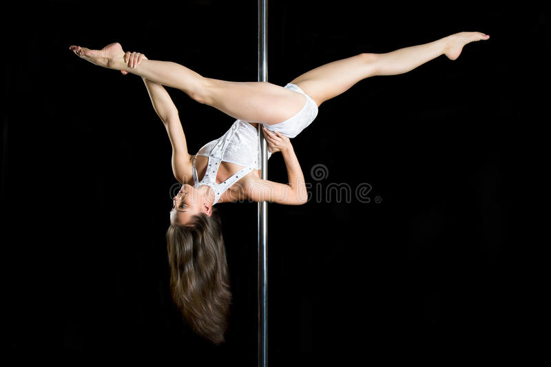 Young Woman Exercise Pole Dance Stock Photography