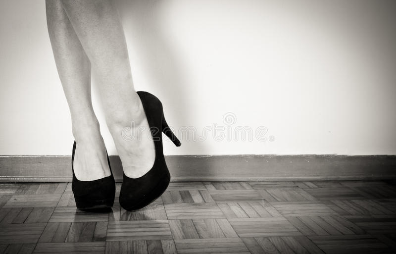 Young woman feet with black high heels and legs, close up stock photo