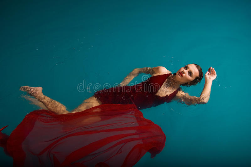 Download Young Woman Floating On Swimming Pool Stock Photos - Image: 27053243