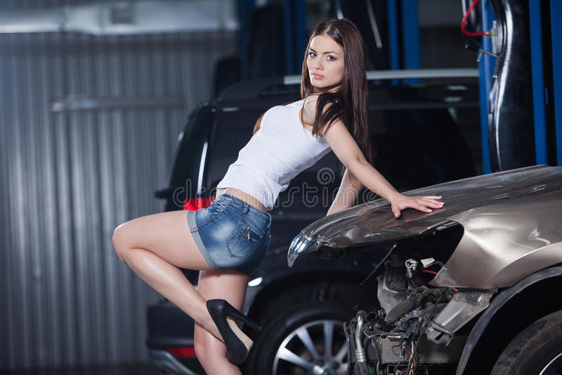 Young and woman in garage stock image