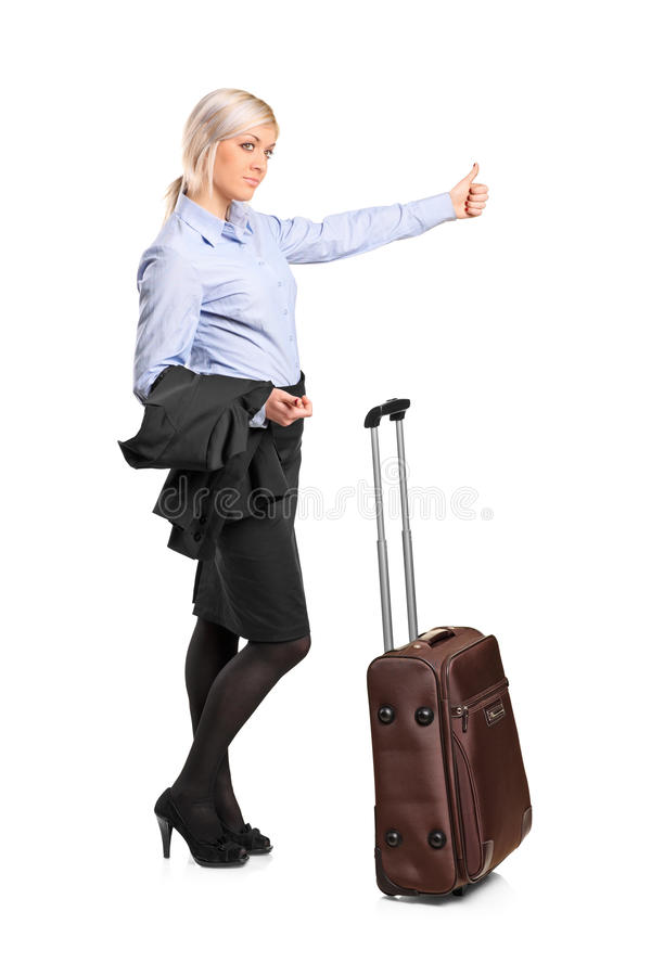 Young woman hitchhiking. Isolated against white background royalty free stock photo