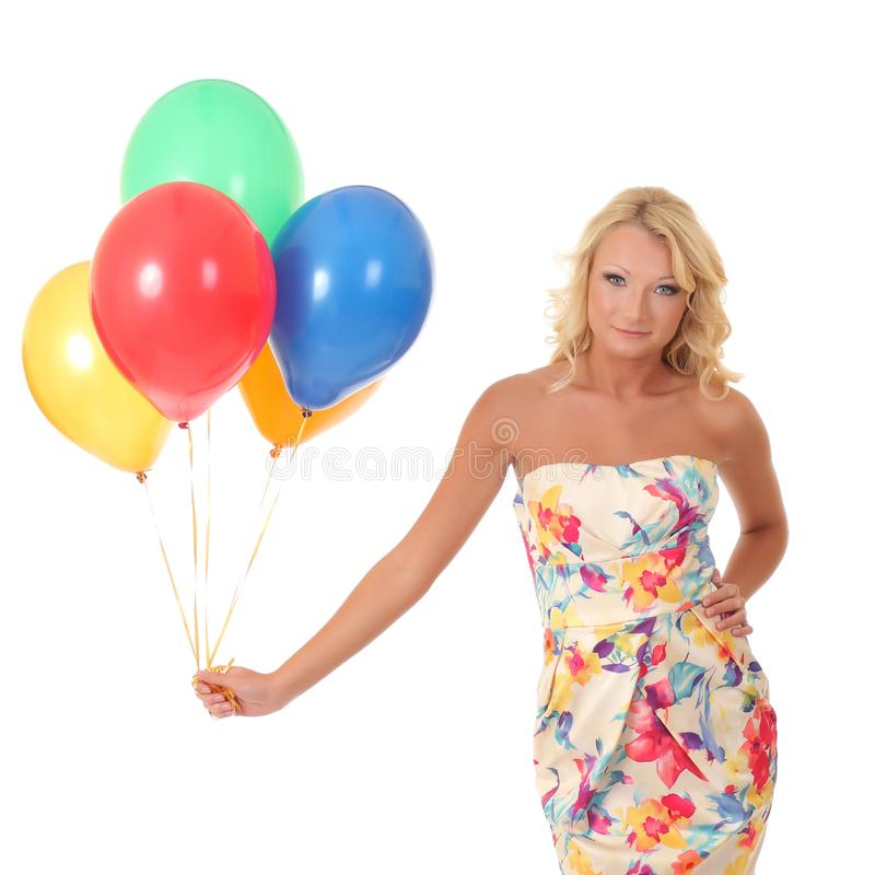 Woman holding balloons stock images