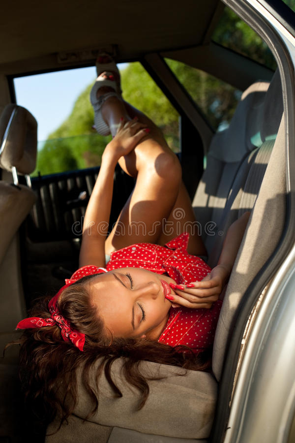 Young woman lay in car - pinup style stock photos