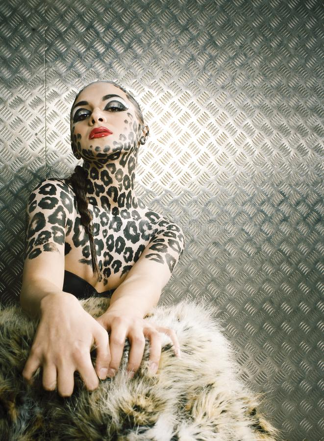 Young woman with leopard make up all over body, cat bodyart. Print closeup stock photos