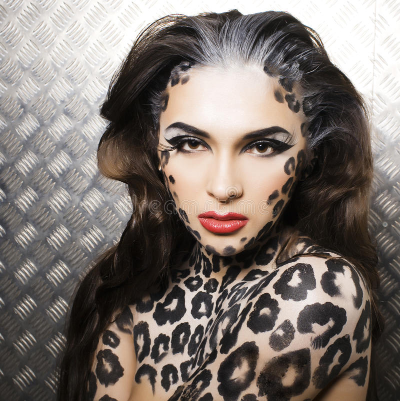 Young woman with leopard make up all over body, cat bodyart. Print closeup sensual stock photography