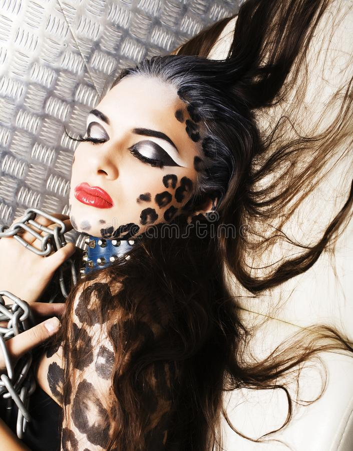 Young woman with leopard make up all over body, cat bodyart. Print closeup sensual royalty free stock photo
