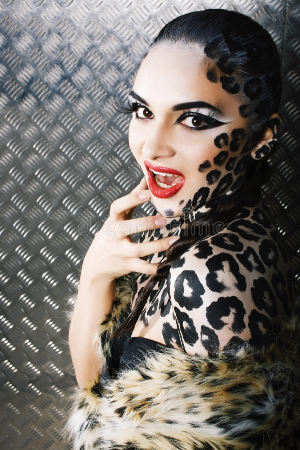 Young woman with leopard make up all over body, cat bodyart. Print closeup sensual stock photos