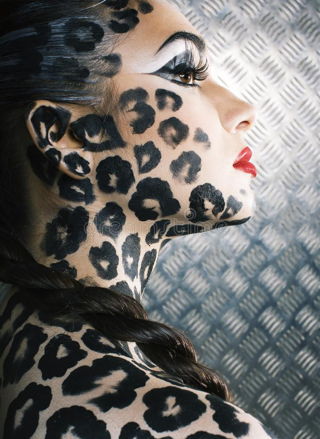 Young woman with leopard make up all over body, cat bodyart. Print closeup royalty free stock image