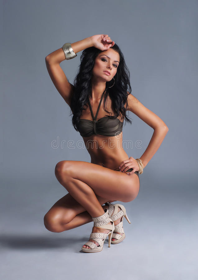 Download Young Woman In Lingerie Over Grey Background Stock Image - Image: 21618797