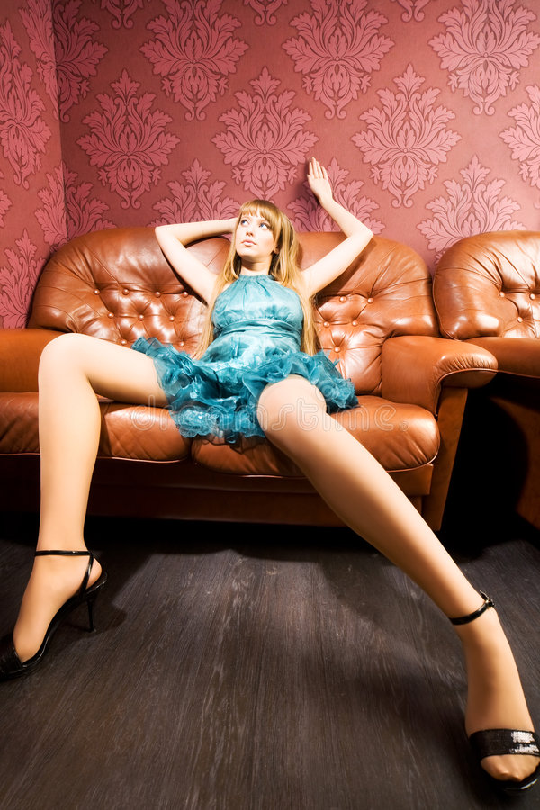 Young sexy woman on a luxury sofa