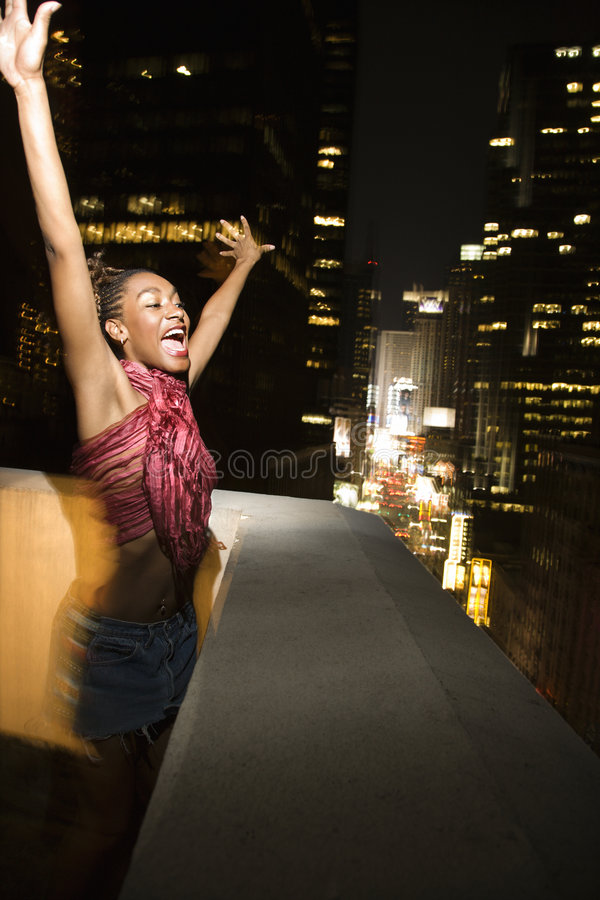 Young woman in New York City, New York at night. stock photo