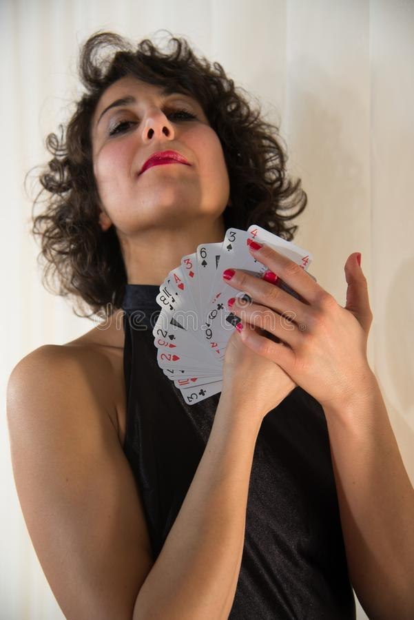 Young woman with playing cards stock images