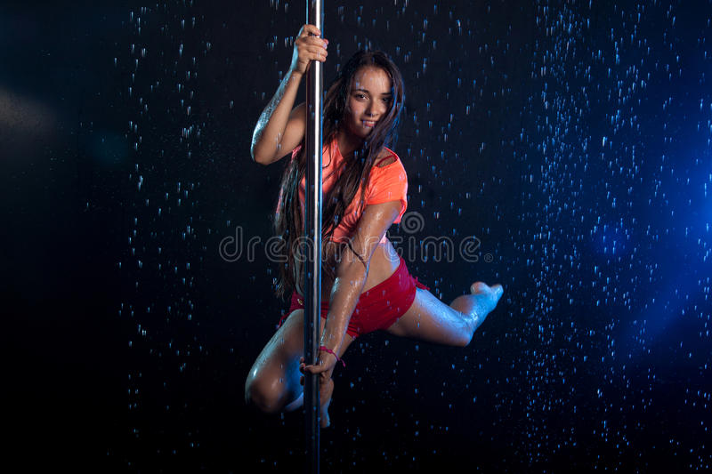 Young woman pole dancer. Water studio stock photography