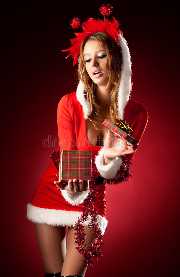 Young woman in santa clothing royalty free stock image