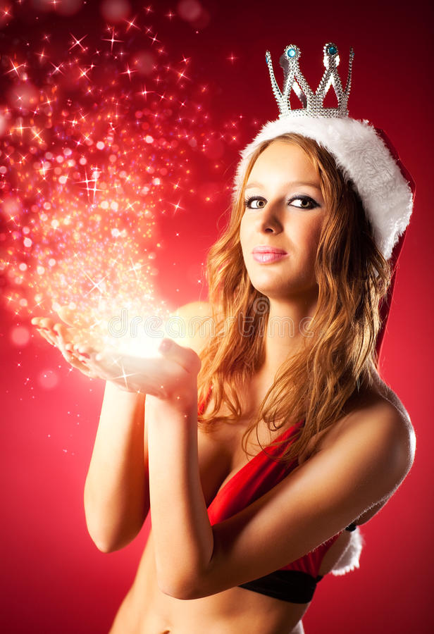Young woman in santa clothing stock photos
