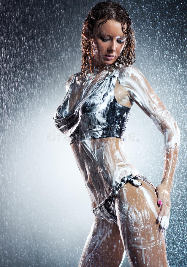 Young woman with soap foam. Water studio photo royalty free stock photography