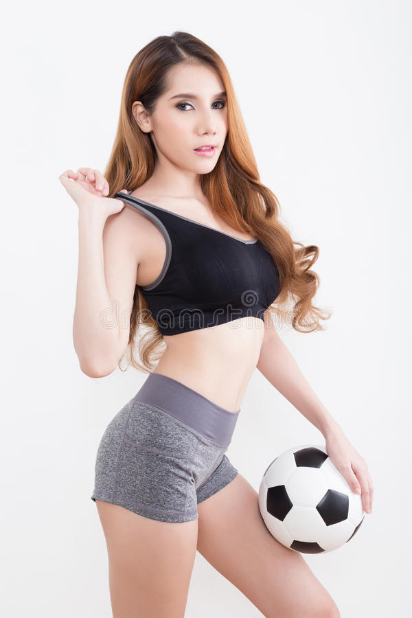 Young woman with soccer ball. Young woman in sports ware with soccer ball isolated on white background stock images