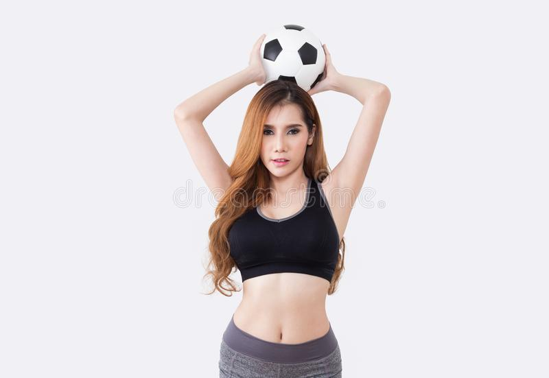 Young woman with soccer ball. Young woman in sports ware with soccer ball isolated on white background royalty free stock photography