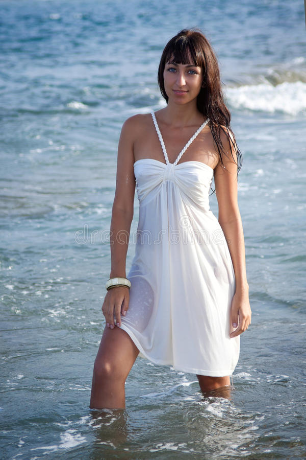 Young woman standing in the ocean water. stock images